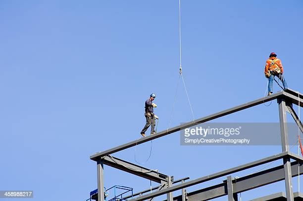 steel construction workers - high up stock photos and pictures