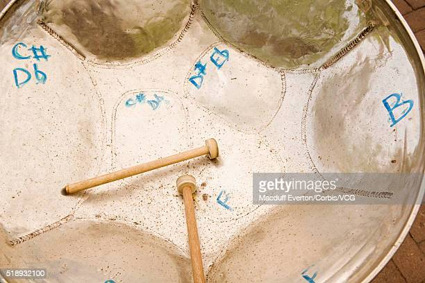 steel drum and drumsticks - steel drum stock photos and pictures