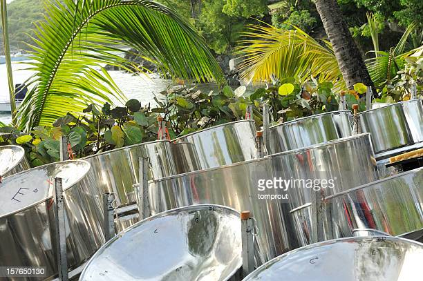 steel drums in tropical setting - steel drum stock photos and pictures