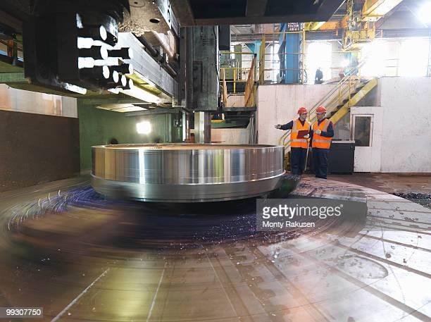 Steel Engineers With Lathe