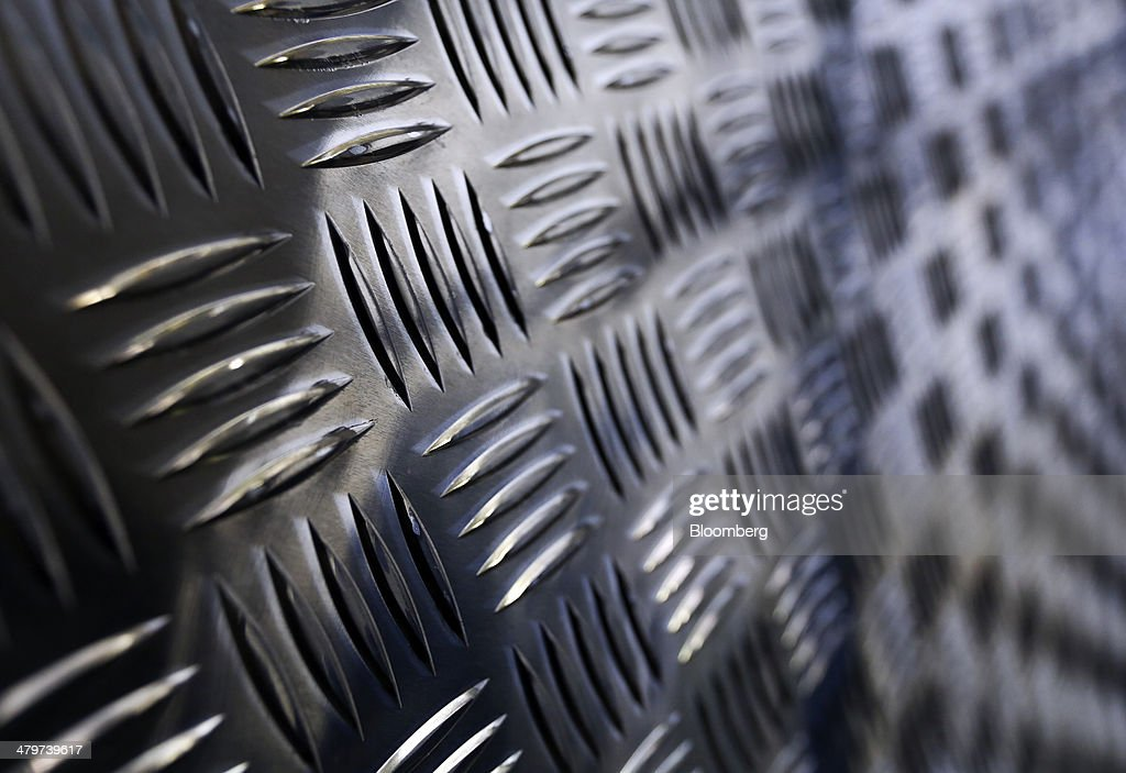 Steel foot plates sit on a storage rack in the warehouse at Metal Supermarkets in Southampton, U.K., on Friday, Nov. 15, 2013. The Bank of England sees gross domestic product rising 0.9 percent this quarter before easing in the early part of 2014, according to its new projections. Photographer: Chris Ratcliffe/Bloomberg via Getty Images