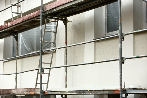 Steel frame framework is the most common way to freely work outside the building to repair façade insulation or renovation. 952922224