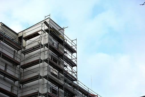 Steel frame framework is the most common way to freely work outside the building to repair façade insulation or renovation. 952923150