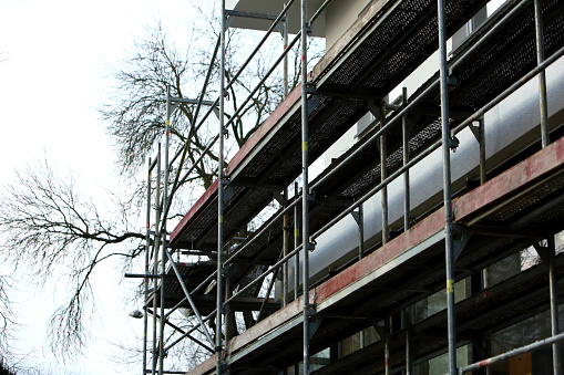 Steel frame framework is the most common way to freely work outside the building to repair façade insulation or renovation. 952927180