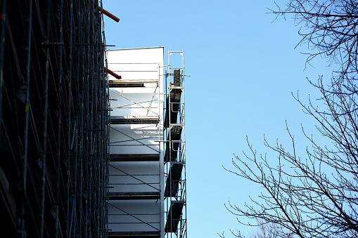 Steel frame framework is the most common way to freely work outside the building to repair façade insulation or renovation. 952927858