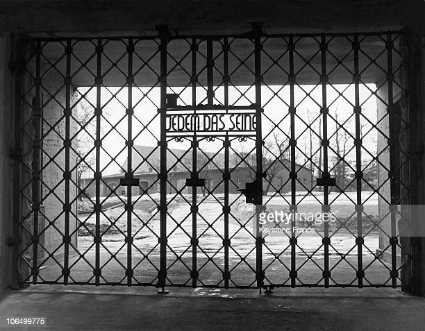 Steel Gate At The Extermination And Concentration Camp In Buchenwald On Which Can Be Read Jedem Das Seine In The Background The Barracks The Camp...