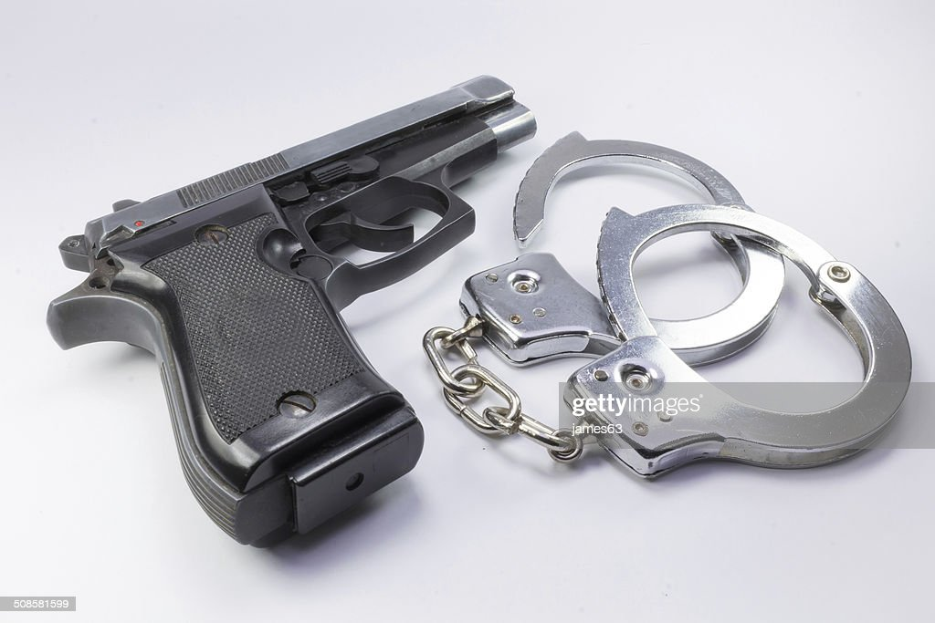 steel gun and handcuffs to stop criminals : Stock Photo