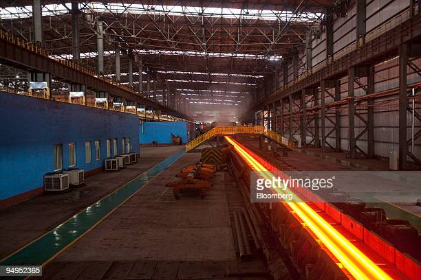 A steel Hbeam moves down the production line at the China Oriental Group Co steel plant in Tangshan Hebei province China on Saturday Aug 29 2009...