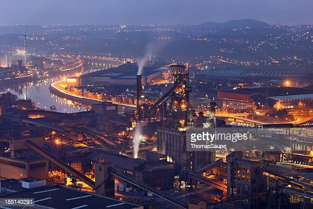 steel mill at night - meuse river stock photos and pictures