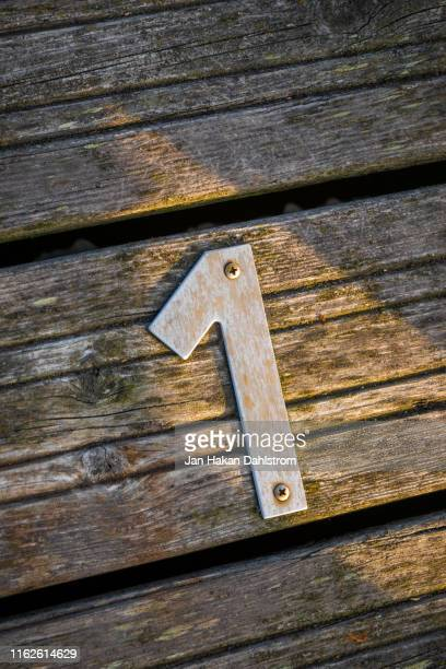 steel number 1 on wood - number 1 stock pictures, royalty-free photos & images