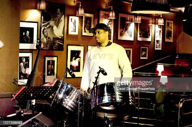 Steel pan player Samuel Dubois performs in rehearsal on stage at Ronnie Scott's Jazz Club in Soho London on 7th March 2013