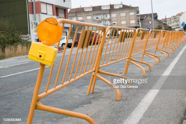 steel pedestrian safety barrier /  traffic barricade - barricade stock photos and pictures