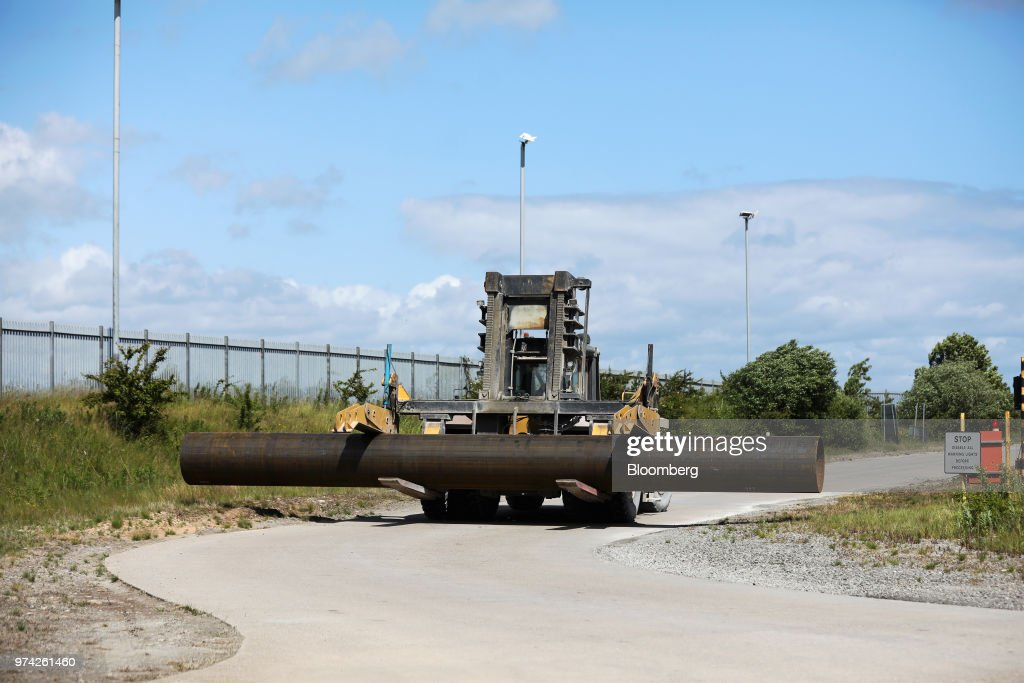 A steel pipe is transported by a forklift truck at the SAW Pipe Mills, operated by Liberty Commodities Ltd., in Hartlepool, U.K., on Thursday, June 14, 2018. Steel and aluminumtariffsimposed by the U.S. in March may already be filtering through to prices charged by American producers of the metals. Photographer: Chris Ratcliffe/Bloomberg via Getty Images