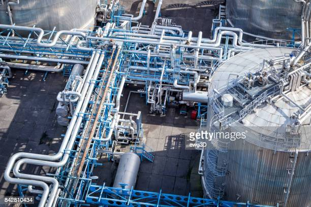 steel pipelines in the refinery - gas refinery stock photos and pictures