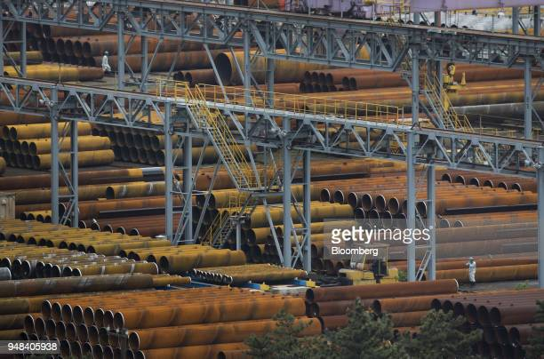 Steel pipes ait stacked near the Nippon Steel Sumitomo Metal Corp plant in Kashima Ibaraki Japan on Wednesday April 18 2018 President Donald...