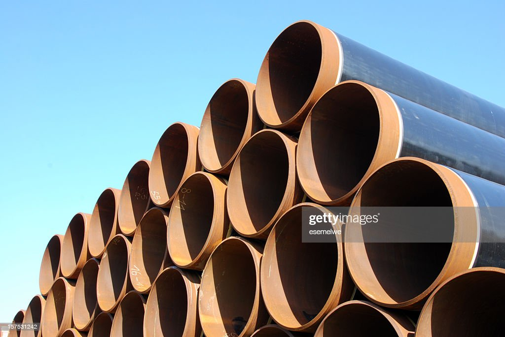 Steel pipes neatly stacked in rows : Stock Photo