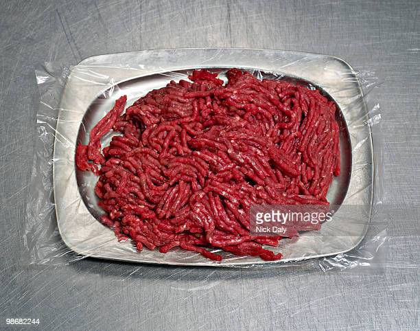 a steel plate of minced meat - ground beef stock pictures, royalty-free photos & images