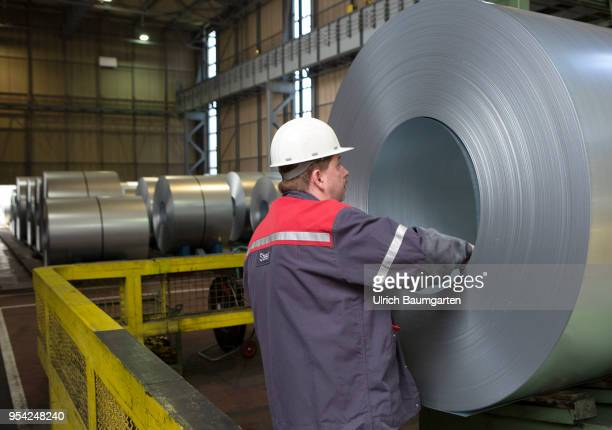 Steel production at ThyssenKrupp in Duisburg The picture shows a worker at a finished produced steel roll in a storage hall for coldrolled sheet