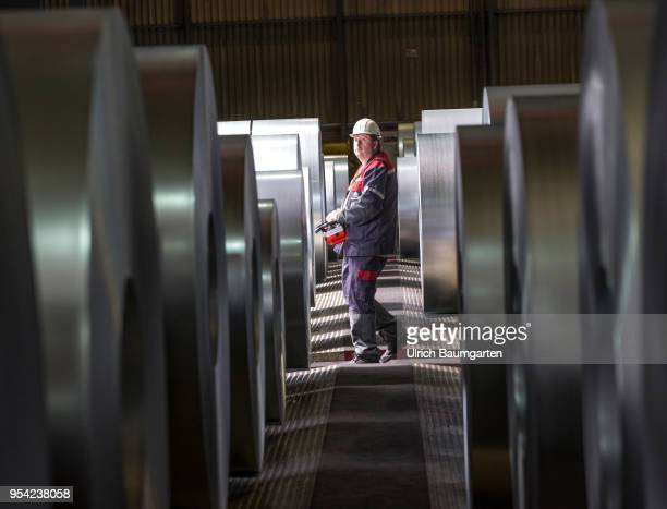 Steel production at ThyssenKrupp in Duisburg The picture shows a worker between steel rolls in a storage hall for coldrolled sheet