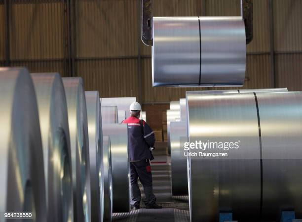 Steel production at ThyssenKrupp in Duisburg The picture shows a worker during transport of a steel roll in a storage hall for coldrolled sheet