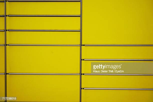 Steel Rack Against Yellow Background