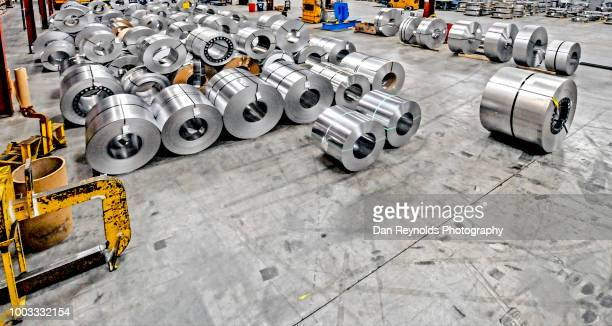steel rolls in steel mill - steelmaking stock photos and pictures