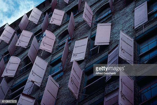 Steel shutters on a building in Lower Manhattan New York City 1988