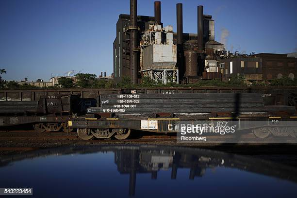 Steel slabs sit on flatcars after being manufactured at the ArcelorMittal steel mill complex in Cleveland Ohio US on Friday June 24 2016 Benchmark US...