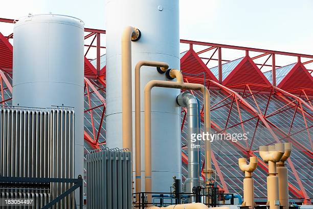 steel tanks in modern industry - red tube top stock photos and pictures