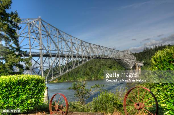 steel truss bridge of the gods view with old wheels - hood river stock pictures, royalty-free photos & images