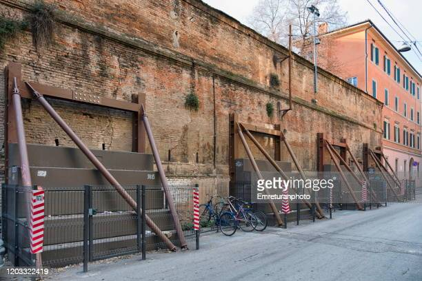 steel wall supports on an old brick wall in bologna. - emreturanphoto stock pictures, royalty-free photos & images