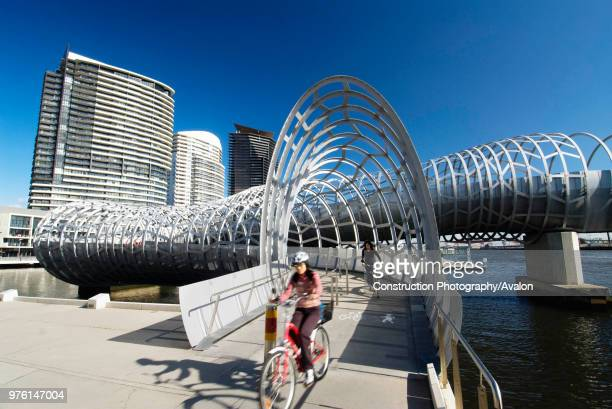 Steel Webb footbridge in Docklands district of Melbourne, Australia; Designer Denton Corker Marshall.
