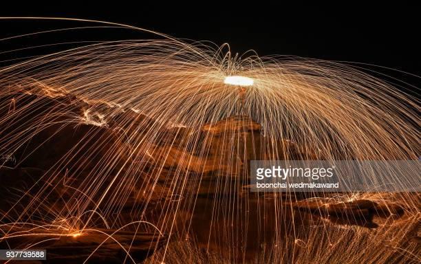 Steel wool on beach, fire dance show