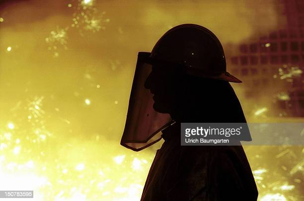Steel worker at the blast furnace tap of the Salzgitter AG