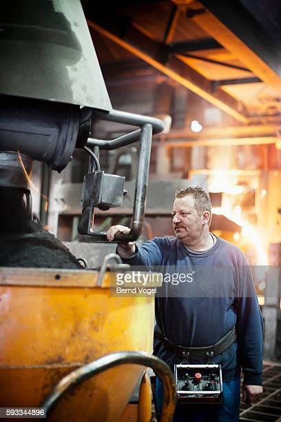Steel worker in factory