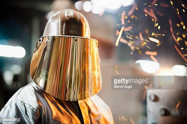 Steel worker in protective headwear
