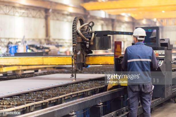 steel worker on cnc plasma cutter machine - plant stock pictures, royalty-free photos & images