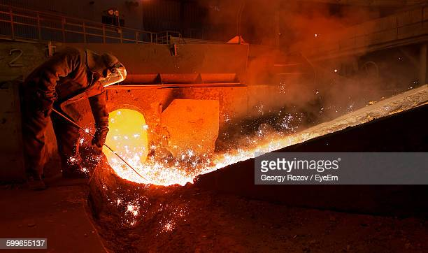 Steel Worker Working In Factory