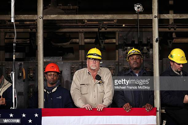 Steel workers listen to US President Barack Obama speak at ArcelorMittal the world's largest steel company November 14 2013 in Cleveland Ohio The...