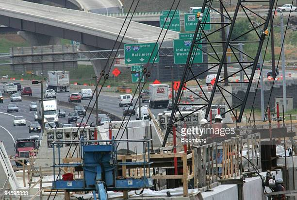 Steel workers position a portion of a workers cross platform on the Inner Loop of new Woodrow Wilson Bridge that will span the Potomac River and...