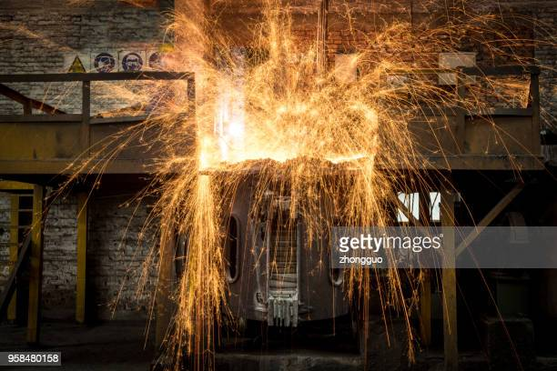 steel workers pouring molten steel - steelmaking stock photos and pictures