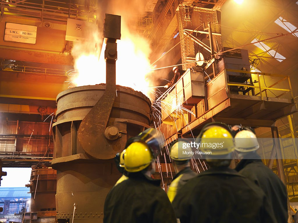 Steel Workers Pouring Molten Steel : Stock Photo