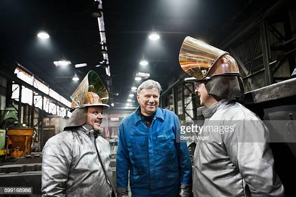 Steel workers talking