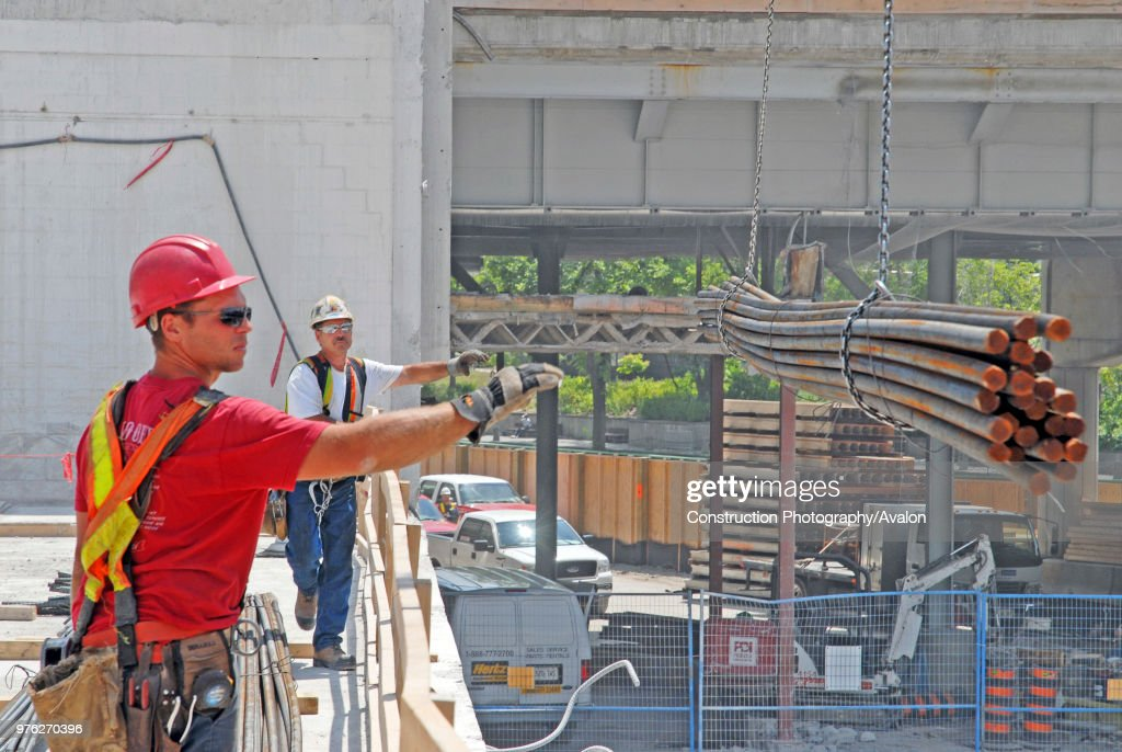 steel workers, unoading of rebar, from crane, PCL