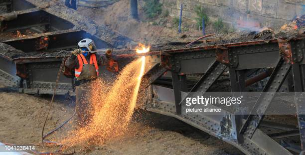 Steel workers use a blowpipe to dismantle an old iron bridge in Magdeburg Germany 20 April 2017 The bridge elements weigh up to 40 tons and are 22...