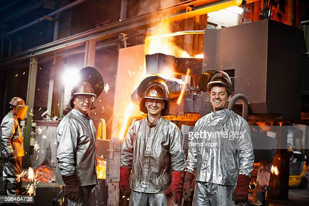 Steel workers working with liquid metal