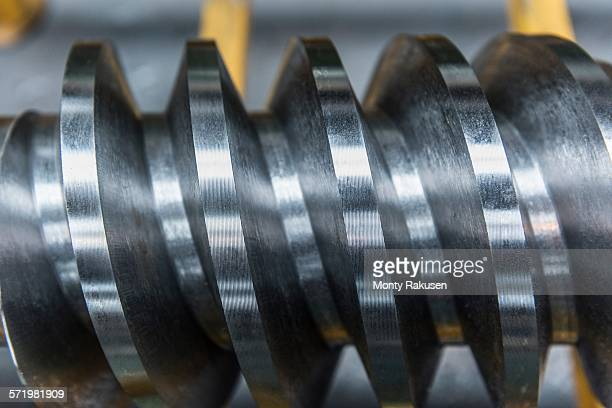 Steel worm drive gear in engineering factory, close up
