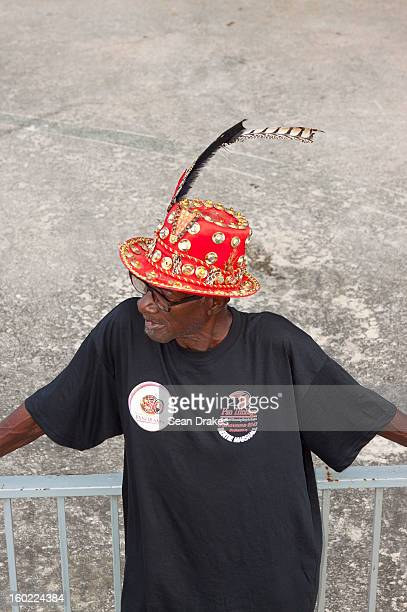 Steelband fan in wacky hat looks on at Panorama semifinals at Queen's Park Savannah in Port of Spain Trinidad and Tobago on January 27 2013 Carnival...