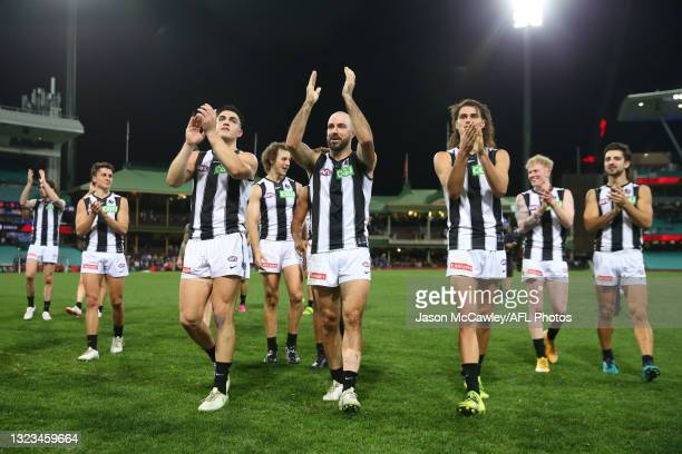 Steele Sidebottom of the Magpies celebrates victory during the round 13 AFL match between the Melbourne Demons and the Collingwood Magpies at Sydney...