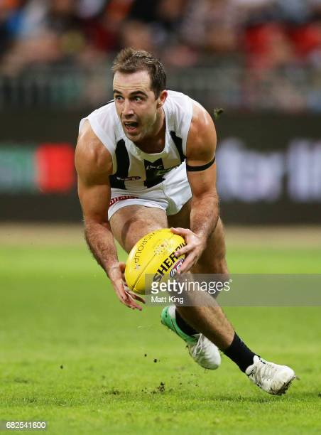 Steele Sidebottom of the Magpies handles the ball during the round eight AFL match between the Greater Western Sydney Giants and the Collingwood...